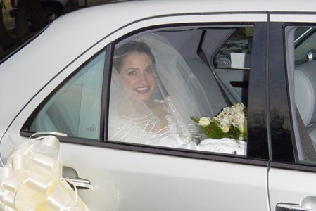 A bride in a wedding car